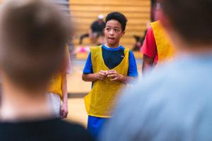 Kid Between Teammates